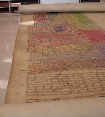 The importance of using carrier sheets, when scanning damaged originals.